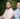 An image of Truecaller's founders in front of green plants